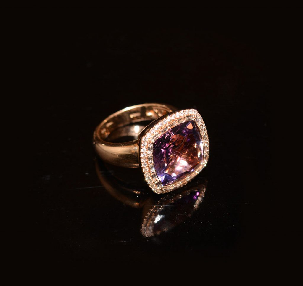 Amethyst-with-a-diamond-halo-set-in-gold