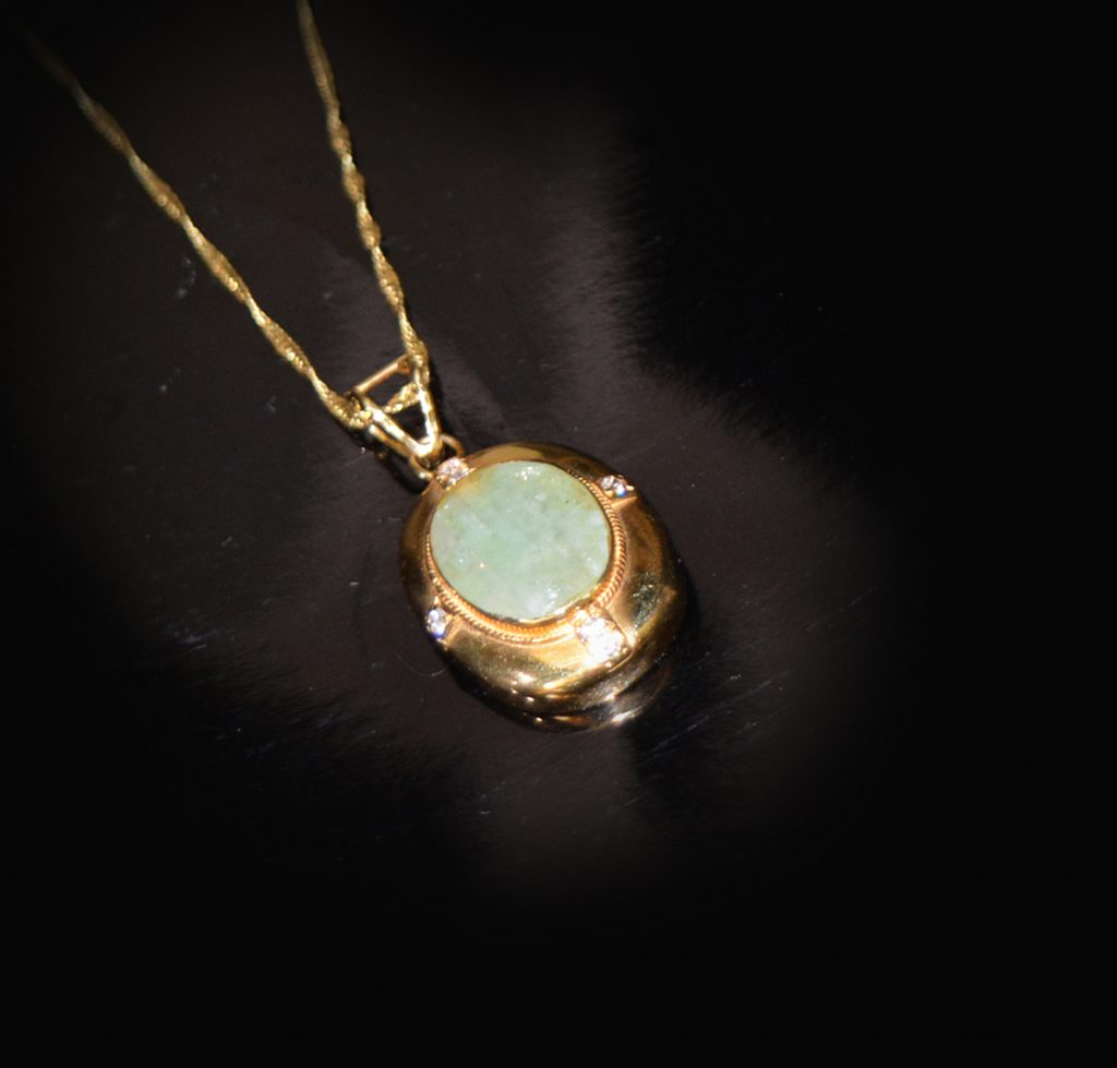 Jade and gold vintage pendant of a fine chain £995.00